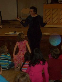 [image]Allison tells a story at a Family Dance at Heberton Hall, Keene, NH. Photo by Michael Catanzaro.