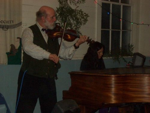 [image]Hunt and Allison play for the Nelson, NH contra dance. Photo by Michael Catanzaro.